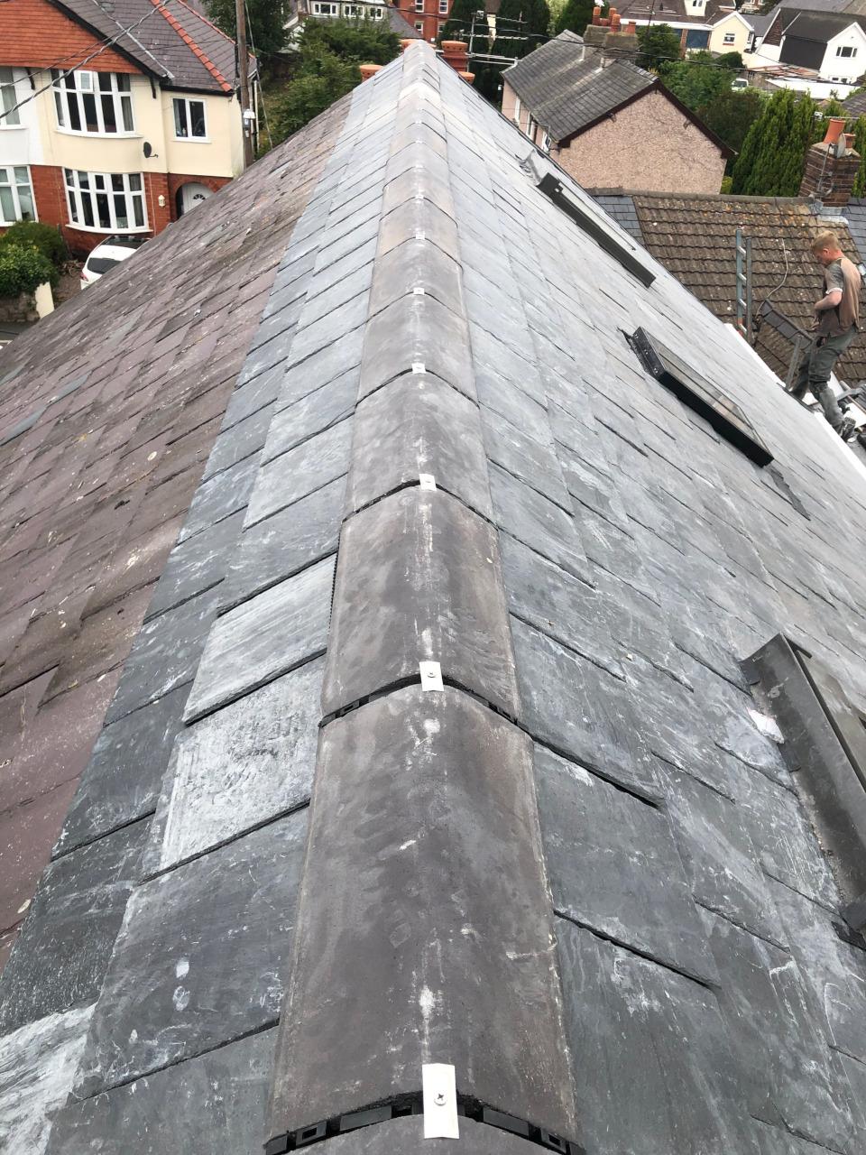 Mechanically fixed ridge tiles.