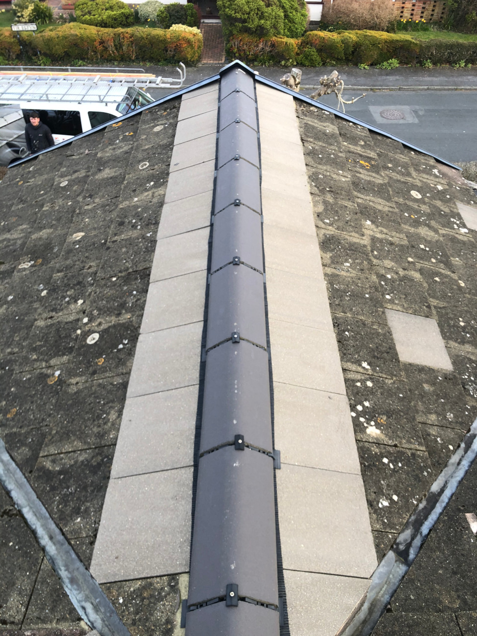 Ridge tile replacement.