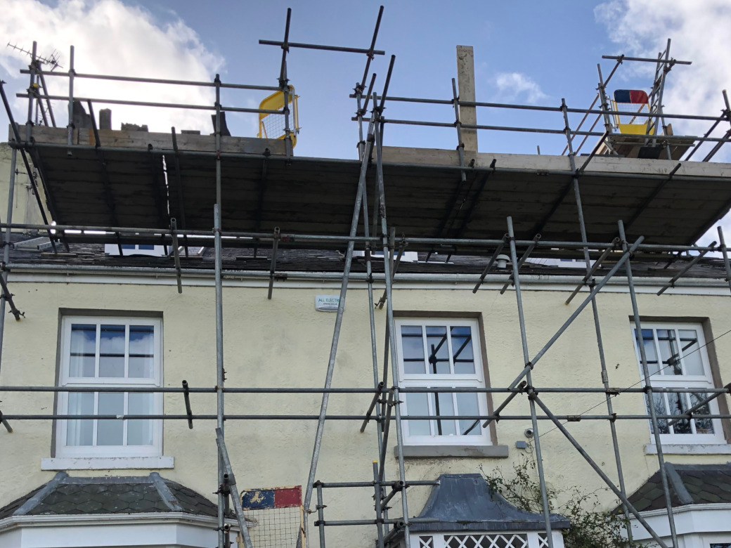 New lead flashings and selective slate replacement.