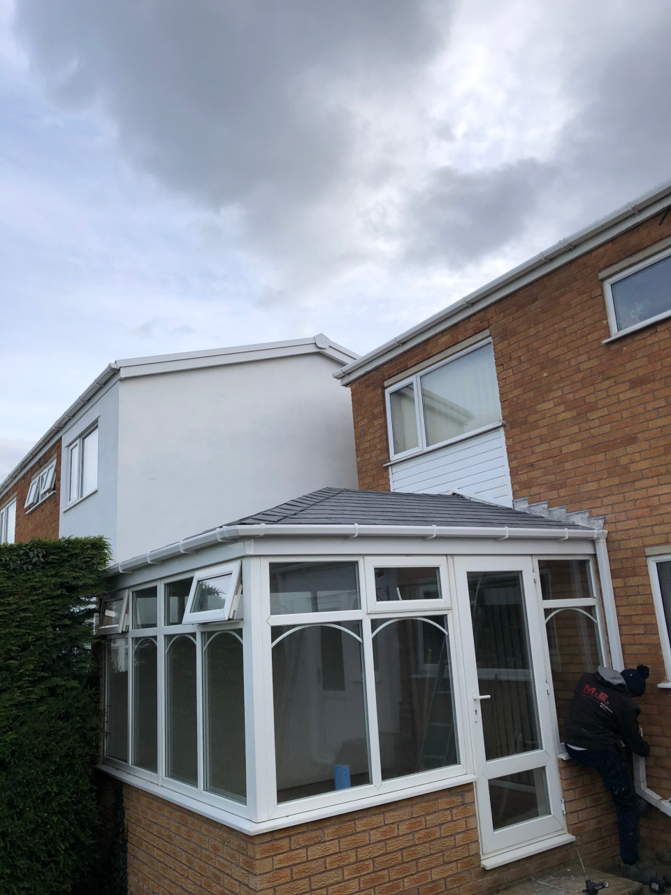 Installation of warm pitched roof on conservatory.